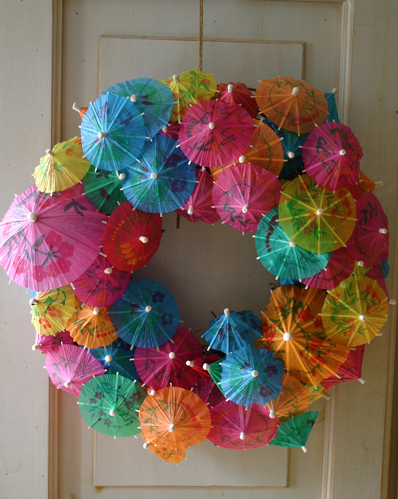 well if this isnt the most clever thing ive seen in a while how cool and easy camilla of family chic created this paper umbrella wreath and has a - Wreath Ideas